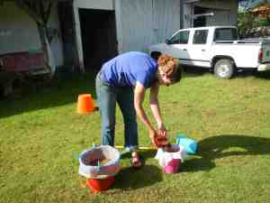 Me floating soils for botanical remains at the New World Archaeological Foundation, summer 2013